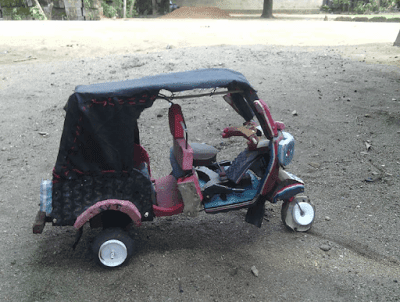 Boy Constructs Keke Napep with Slippers