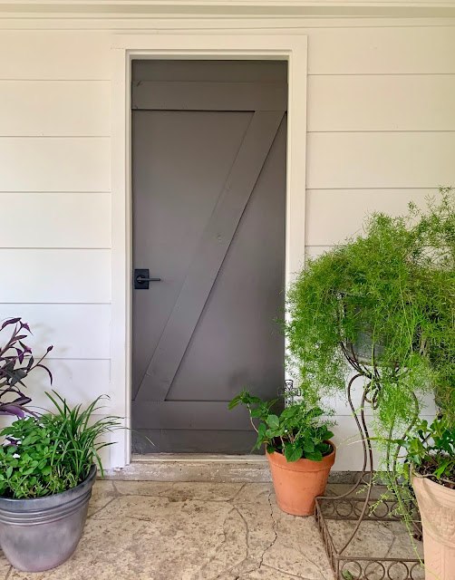 I spruced up the old door between our patio and garage by creating a z brace with 1x6's. It was so simple and gives so much detail to a plain door.