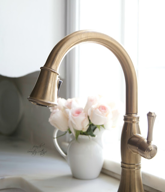 kitchen faucet in champagne bronze with marble