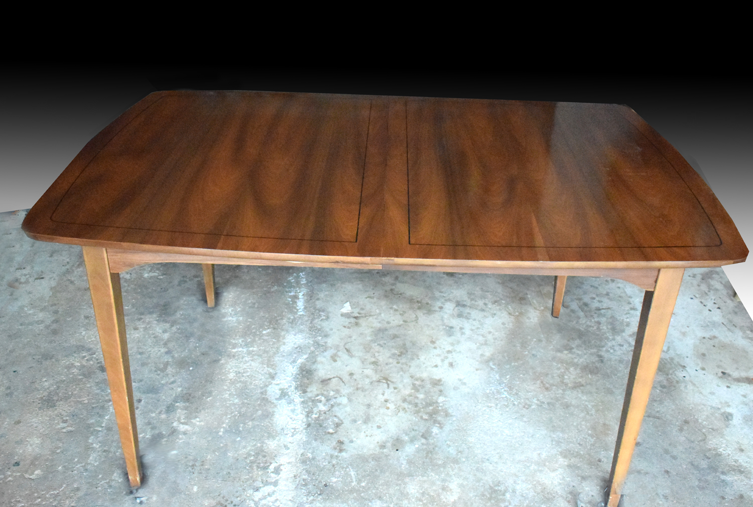 Has been cleaned and re oiled and has a beautiful finish the table is solid and sturdy with sleek tapered legs and surfboard shape no leaf included