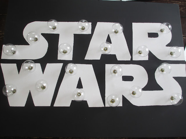 This Star Wars marquee sign is perfect for a Star Wars bedroom, and is so easy to make and costs less than $20! No special tools needed.