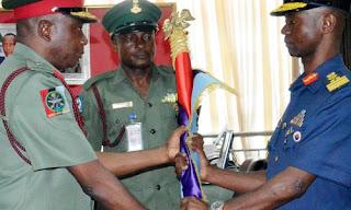 Maj.-Gen.  Sardauna Davies (L), handing over to his successor,  AVM Mohammed Usman,