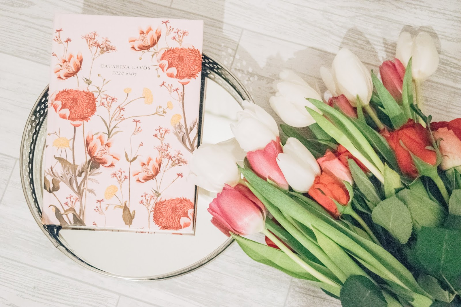 A pink floral 2020 diary with a bunch of flowers.