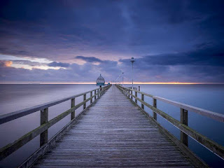 Wooden walkway that stretches into the sea