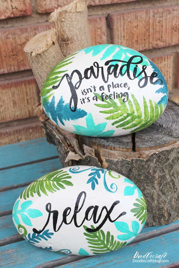Tropical vibe rock painting ideas with ferns and palm leaves made with stencils