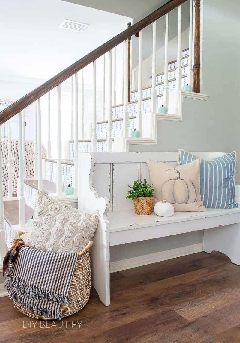 stair wraps and farmhouse bench with aqua pumpkins