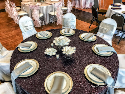 Colleyville Center provided black glitter linens with water lily centerpiece