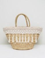 http://www.asos.com/south-beach/south-beach-cream-tassel-crochet-straw-bag/prd/8068051?clr=cream&SearchQuery=BEACH&pgesize=36&pge=14&totalstyles=5609&gridsize=3&gridrow=5&gridcolumn=3