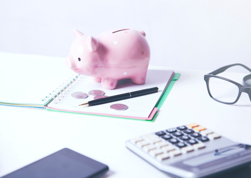 Piggy bank and a calculator in a post about five things I learnt during a low buy year.