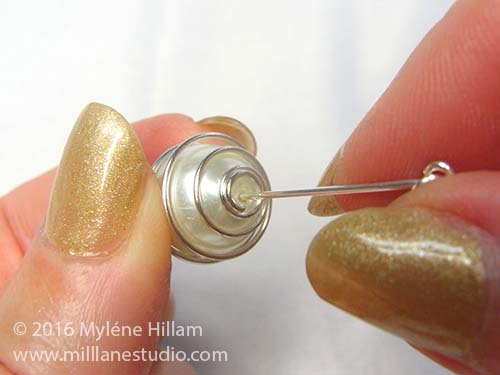 Insert the eye pin into the glass pearl inside the wire bead cage