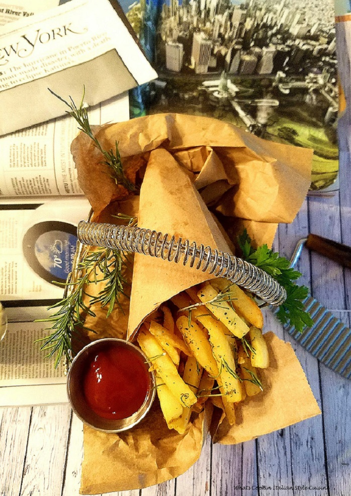 Italian  French Fries seasoned with herbs spices in a basket .   French Fries seasoned with Italian seasoning, crispy fried to perfection. Potatoes or spuds cut like fast food chain french fries that are all spiced up