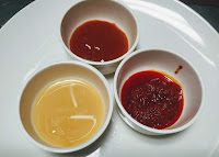 Beaten egg, Chilly sauce and schezwan sauce for Chicken lollipop recipe
