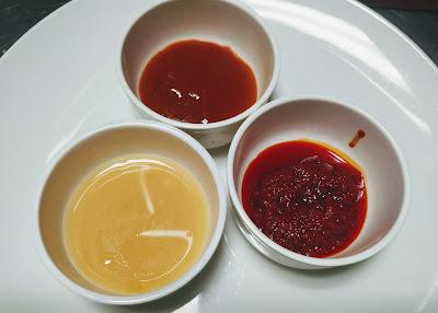 Beaten egg, Chilly sauce and schezwan sauce for Chicken lollipop recipe