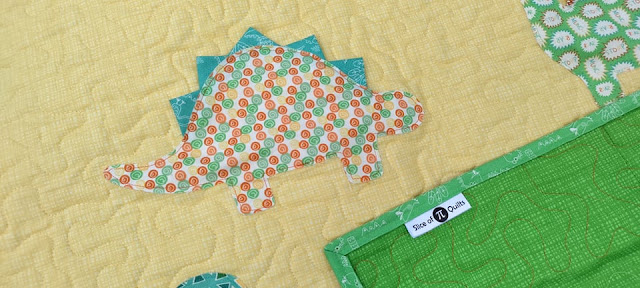 Dinosaur quilt by Slice of Pi Quilts