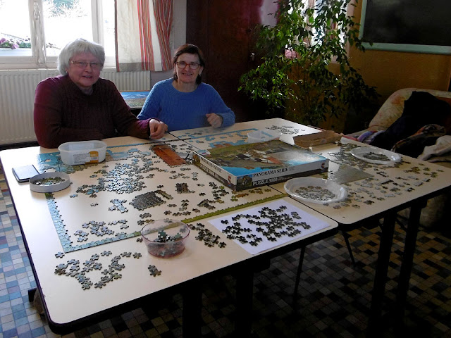 Doing a jigsaw at a community library.  Indre et Loire, France. Photographed by Susan Walter. Tour the Loire Valley with a classic car and a private guide.