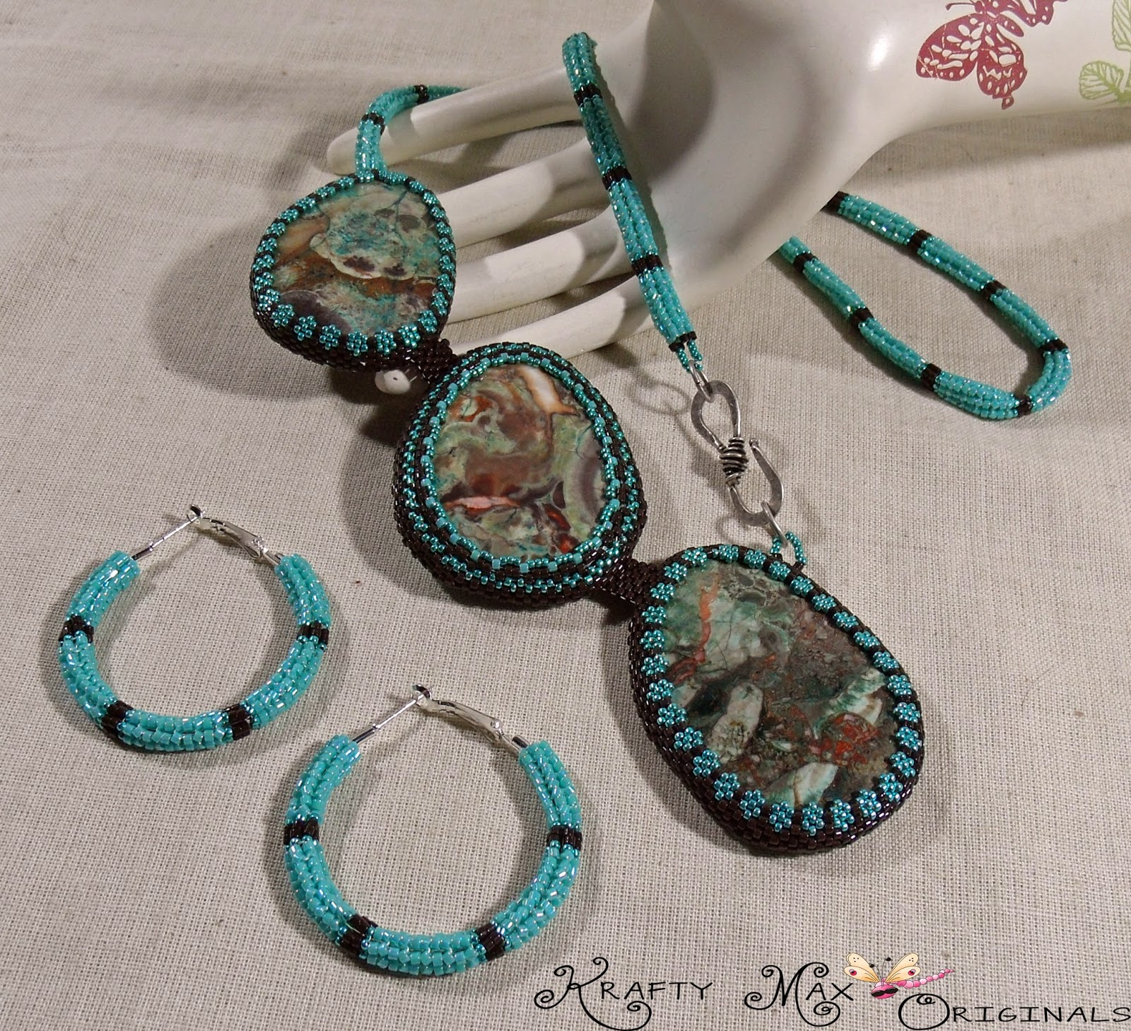http://www.artfire.com/ext/shop/product_view/KraftyMax/8416953/branching_into_winter_-_a_handmade_beadwoven_necklace_by_krafty_max/handmade/jewelry/sets/beadwoven