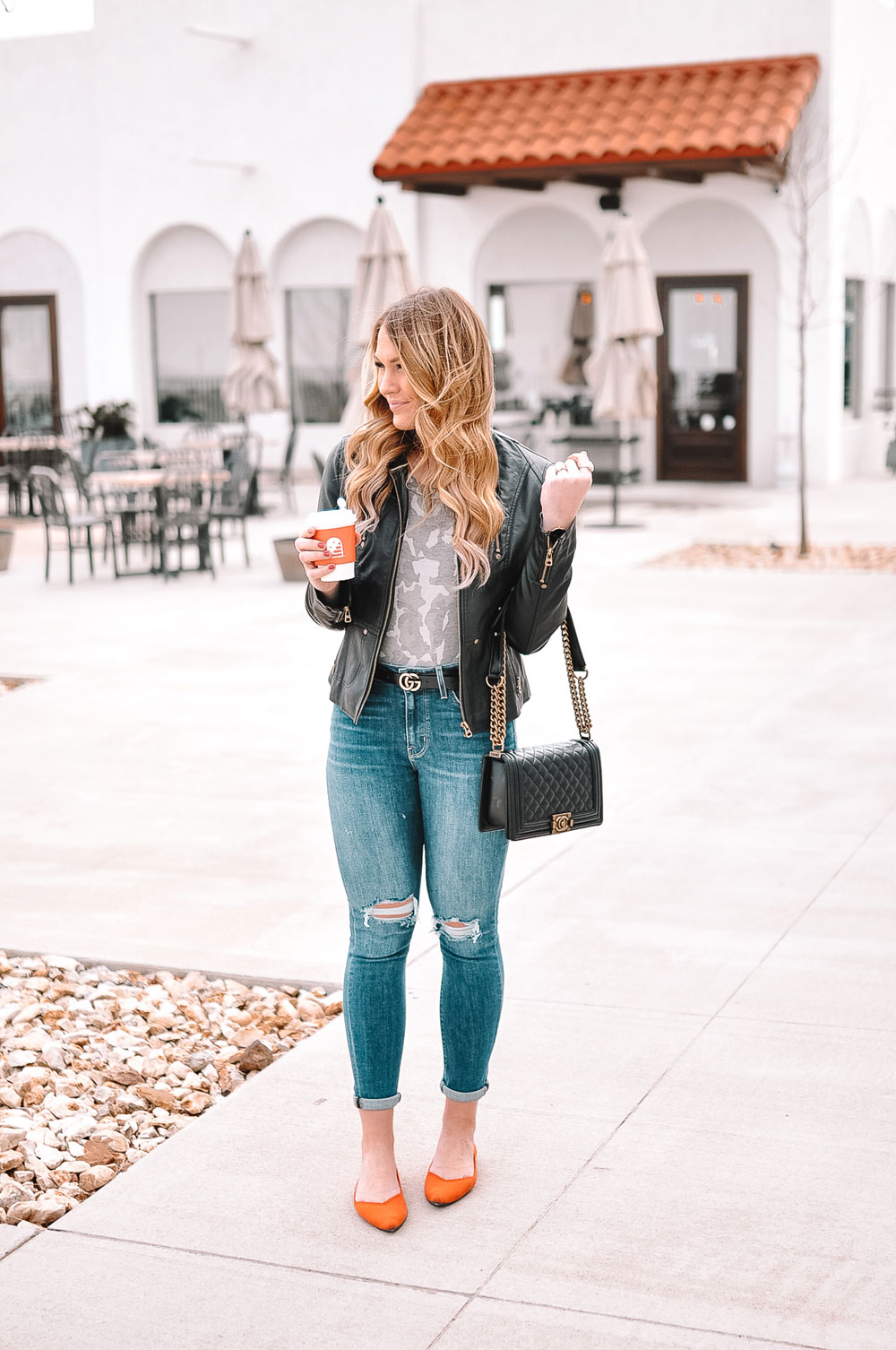 Oklahoma City blogger Amanda Martin wears a camo bodysuit, moto jacket and orange flats