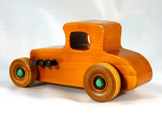 Left Rear - Wooden Toy Car - Hot Rod Freaky Ford - 37 T Coupe - Pine - Amber Shellac - Metallic Green Hubs