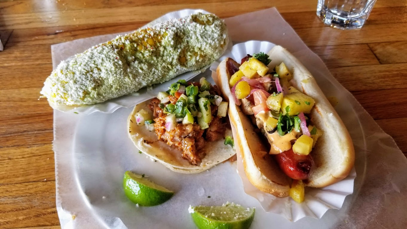 Elote, Taco of the Month (pulled pork), and Bakersfield hot dog, at Imperial (Ferndale)