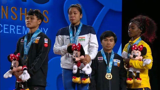 A photo of Chanu Saikhom Mirabai crying after winning gold