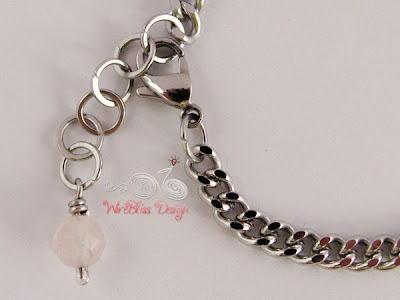 Close up of Wire wrapped Rose Quartz Charm on Minima Bracelet (Minlet)