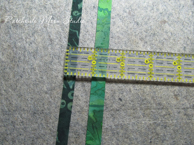 fabric strip showing how fabric stems for flowers are made in 2 sizes