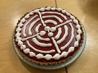 Cranberry curd tart with whipped cream design