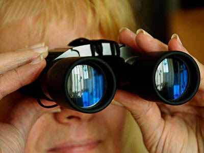 Photo of woman looking through binoculars Photo by 955165 from Pixabay