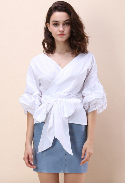 http://www.chicwish.com/enchanting-echo-wrapped-top-in-white.html