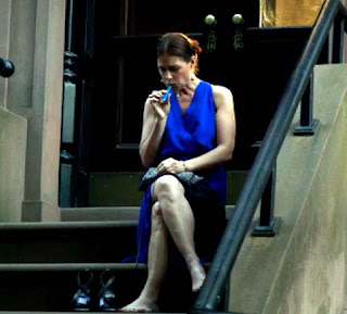 Helen sitting on her stoop, having a vape, not giving AF. Nothing to see here folks, move along.
