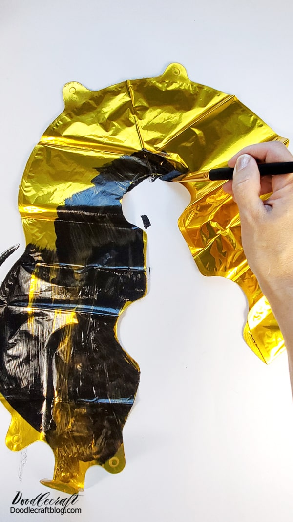 Step 1: Paint the Balloon Open up the package and set the balloon on your work space. Paint the whole thing black, leaving some streaking of metallic to show through. Essentially, these balloons can match any party you throw based on how you paint them!