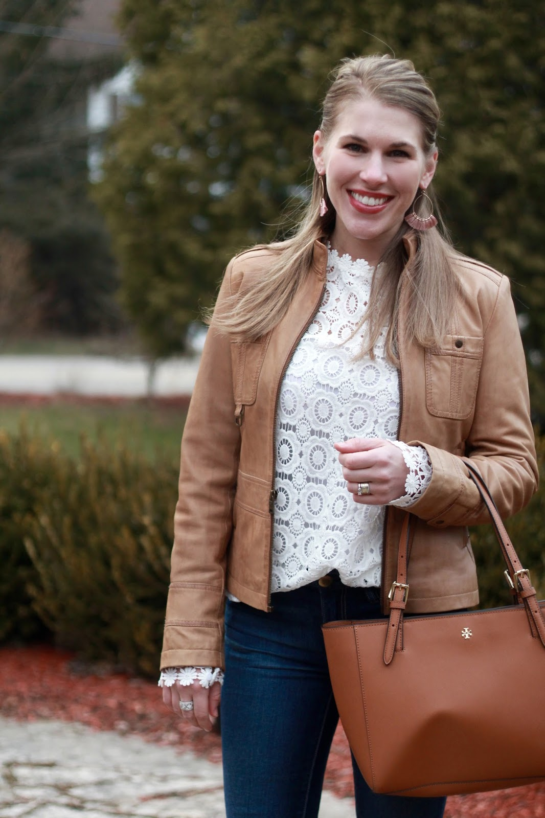 long sleeve white lace blouse, cognac moto leather moto jacket, AEO skinny jeans, blush pumps, Tory Burch cognac tote, casual spring outfit