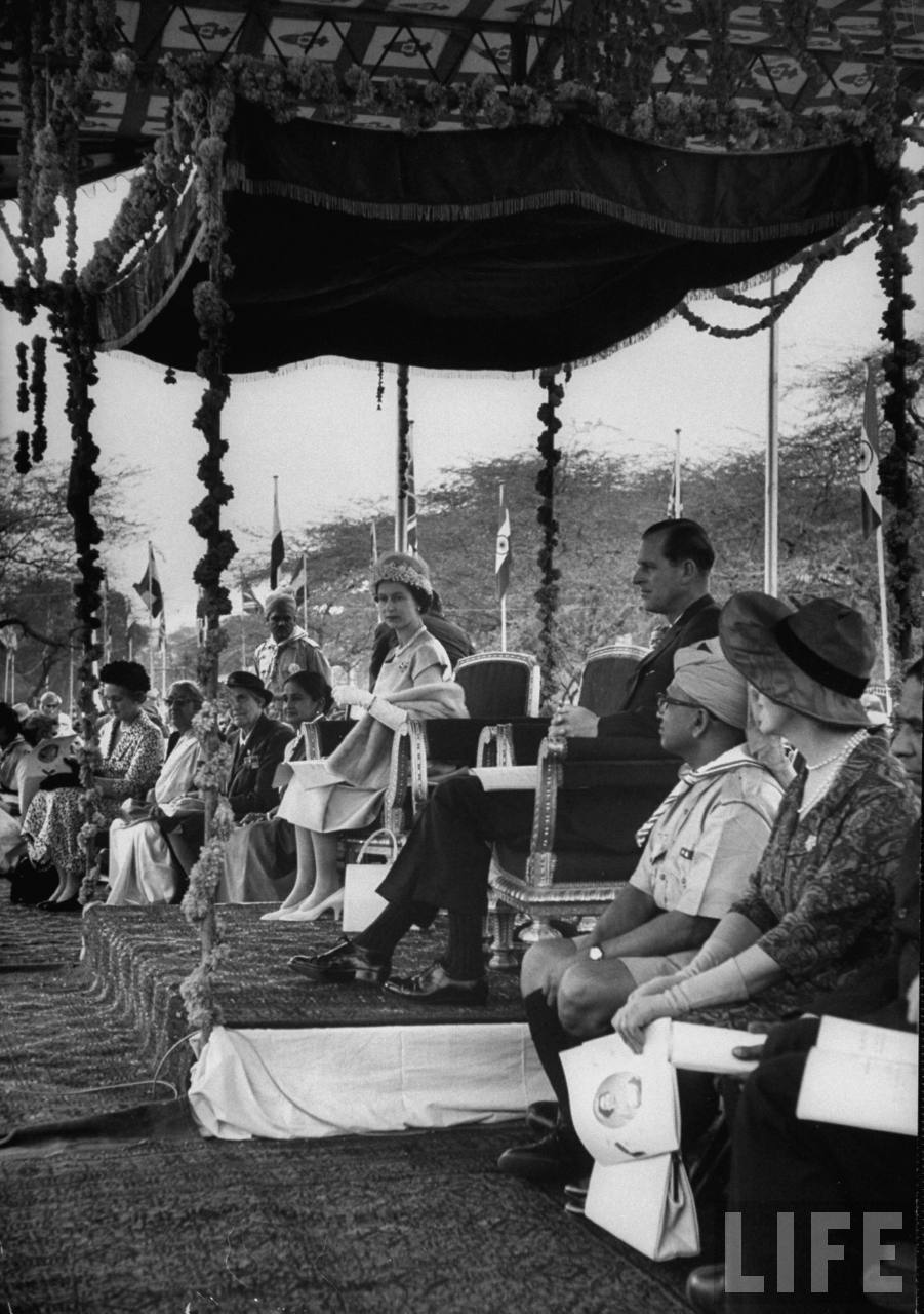 Queen Elizabeth II & Philip attending rally in their honor during their visit to India.