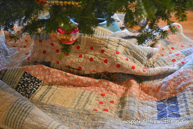old quilt used as Christmas tree skirt