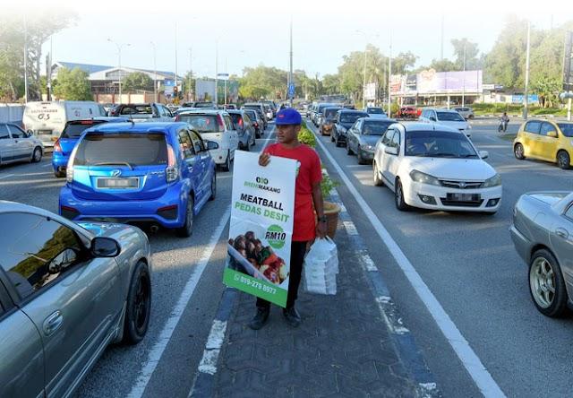 Penjaja Lampu Isyarat Berdepan Hukuman Penjara, Denda RM100 Ribu