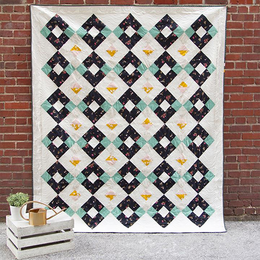 Arcade Quilt designed by Amy Sinibaldi for Live art gallery fabrics, featuring Mayfair Collection