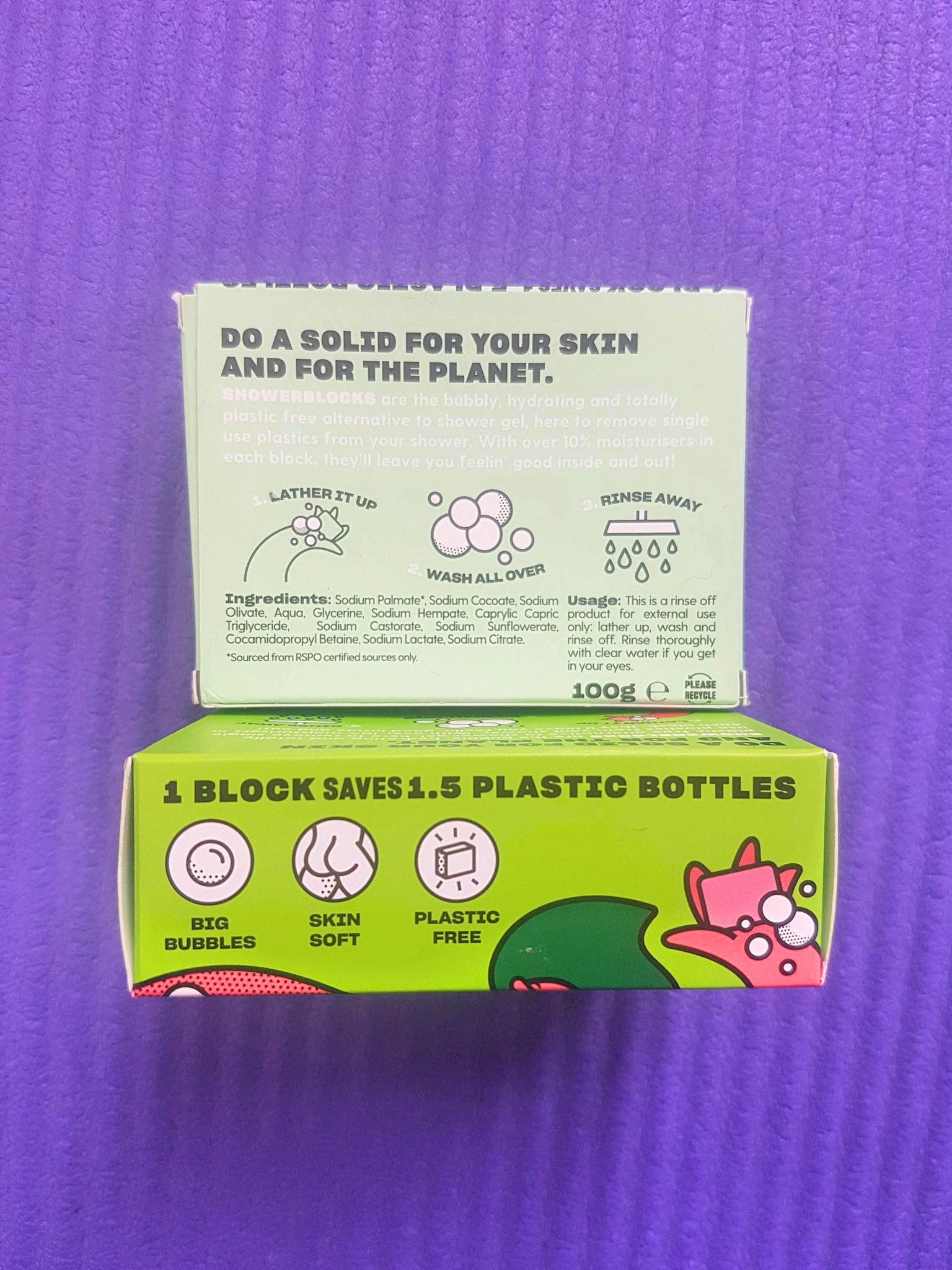 Shower Blocks plastic free shower gel in bright teal and pink + green packaging