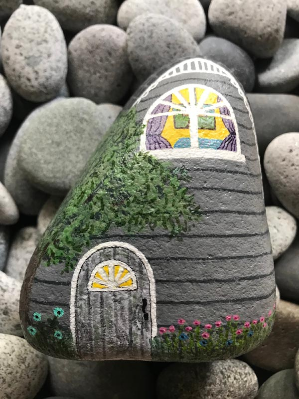 Painted rock house - perfect for fairy door or a little town made out of rocks