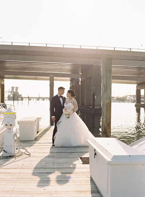 Jin and Christopher outside on the dock at their Bridgeview Yacht Club Wedding