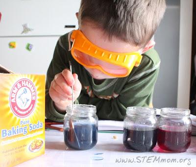 Boy mixing baking soda; pH indicator lab from STEM Mom.org
