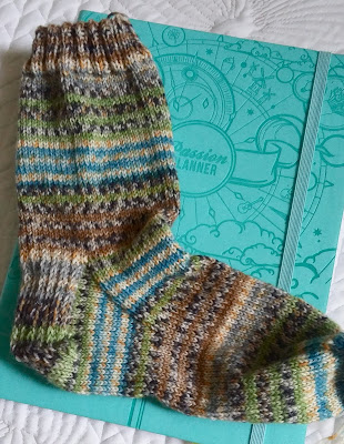 hand knit sock knit from self striping yarn. https://www.etsy.com/shop/JeannieGrayKnits?ref=hdr_shop_menu