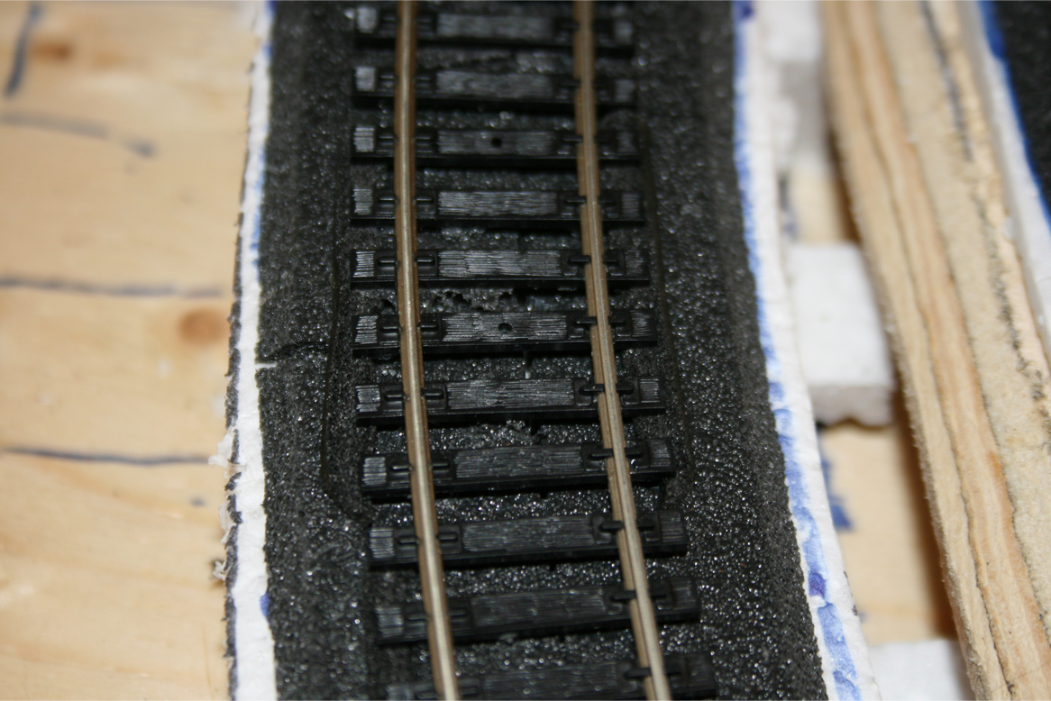 Closeup of track, foam roadbed and foam shims under track ties