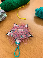 paper stock star wrapped in yarn