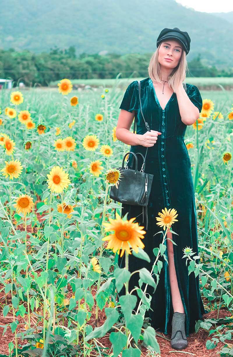 split leg teal velvet maxi dress newboy cap studded boho boots summer outfit in sunflower field