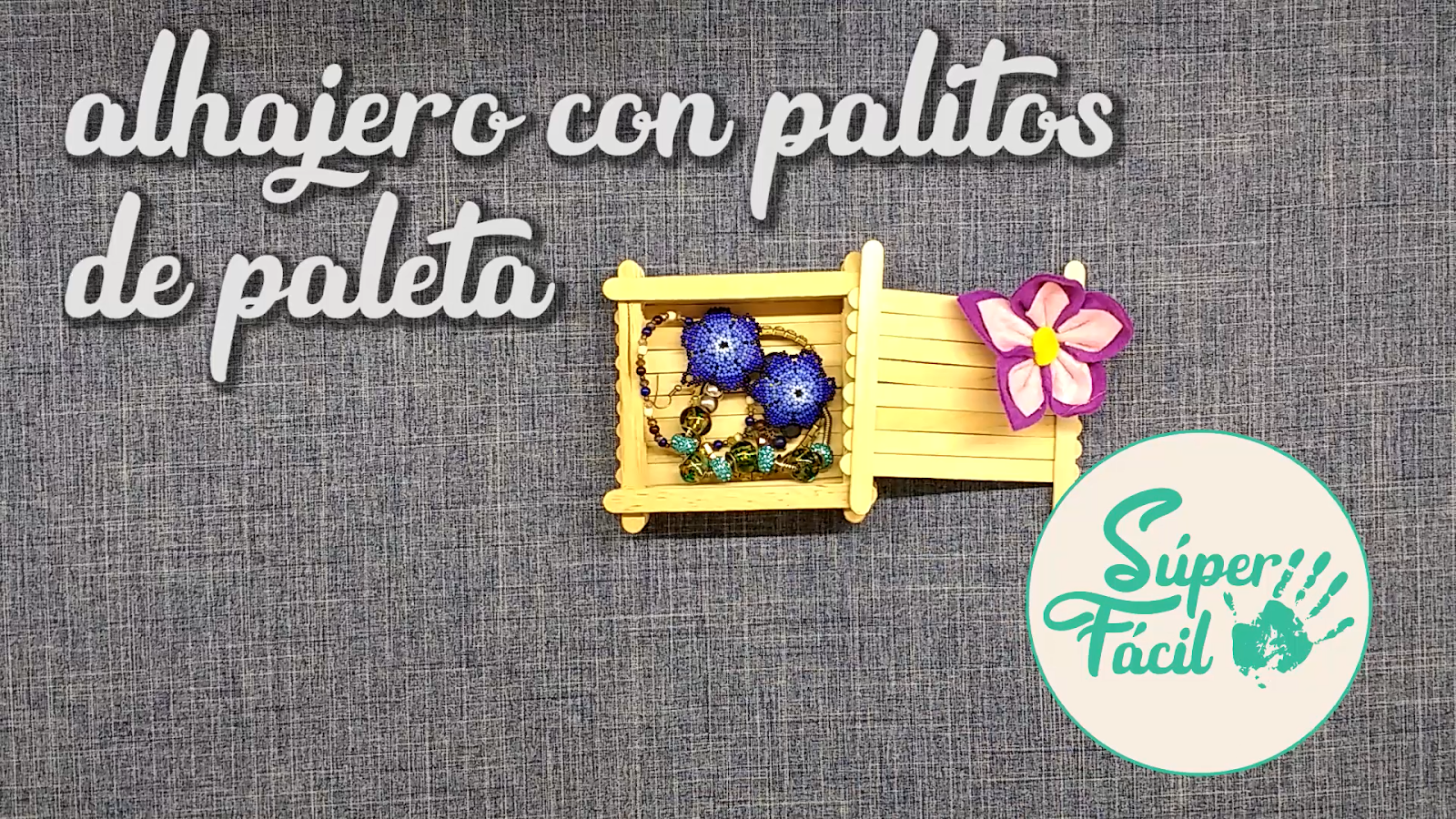 Alhajero hecho con palitos de paleta / Abatelenguas