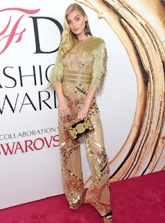 Elsa Hosk in a see through gold lace Naeem Khan jumpsuit with fringe detail at the 2016 CFDA Fashion Awards