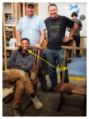 Image of four people in a furniture making workshop