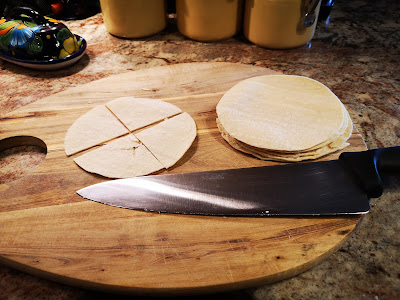 Cut tortillas into chip size pieces