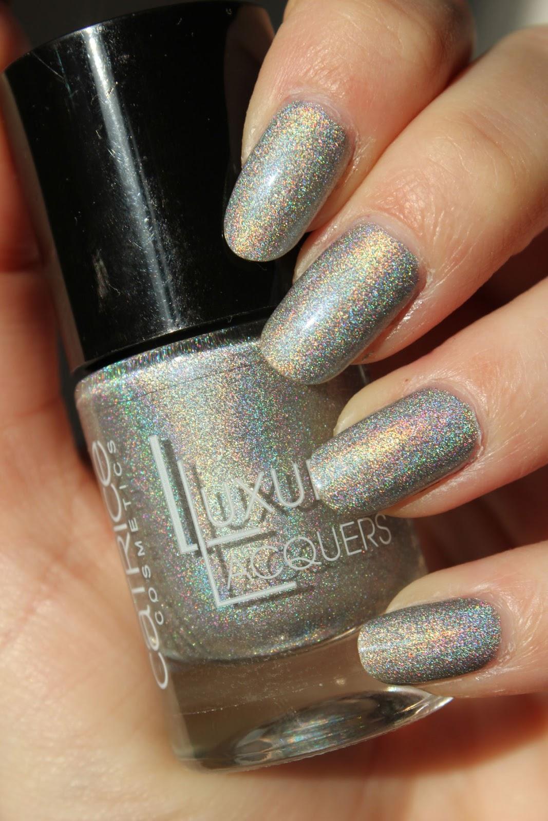 http://lacquediction.blogspot.de/2014/02/catrice-luxury-lacquers-holomania-c01.html