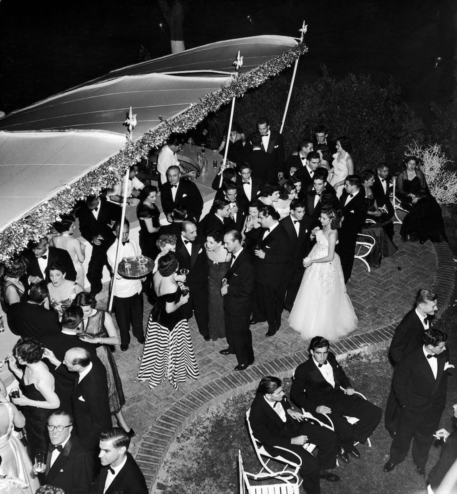 Socialites party under silk canopies in Havana. c. 1950.
